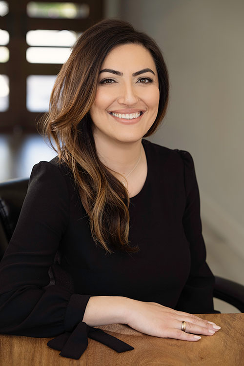 Smiling photo of Naz Ghazi, California family law and immigration attorney