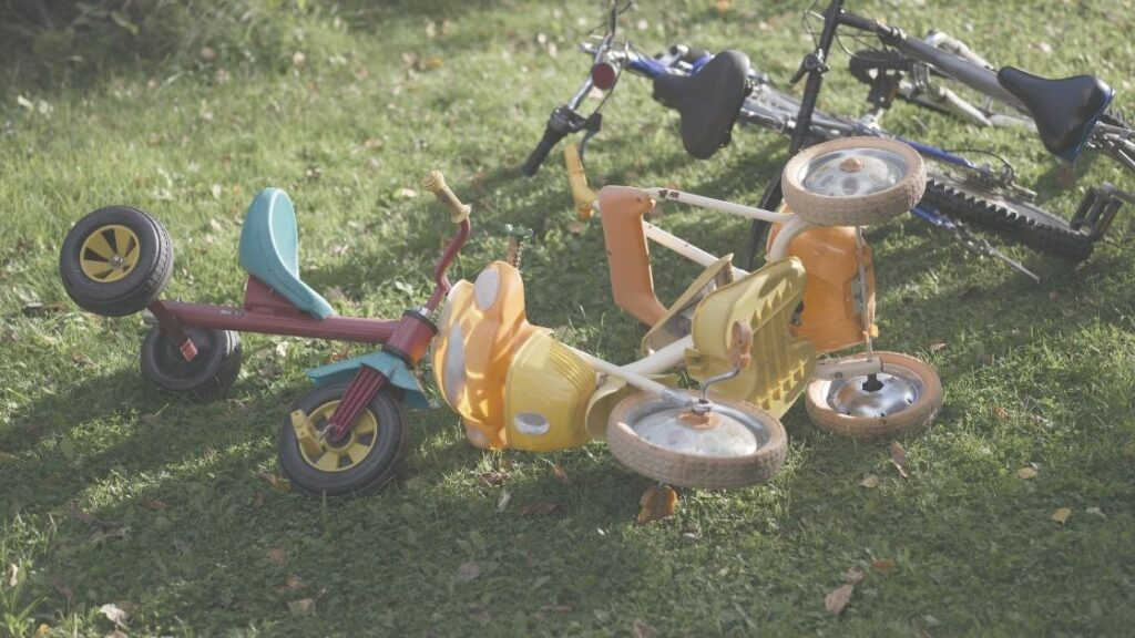 Special Immigrant Juvenile Status - Photo of children's bicycle and tricycle on lawn.